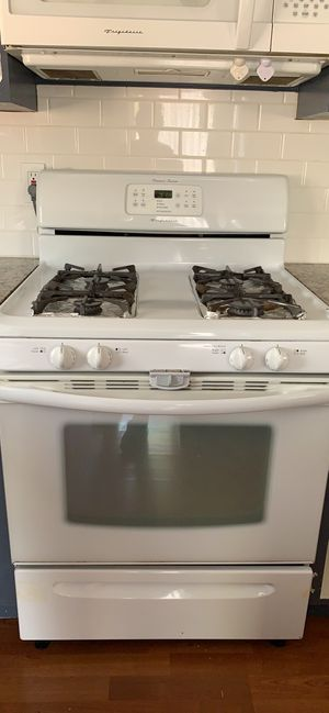 Appliances white gas stove overhead microwave fridge and dishwasher for Sale in Vancouver, WA