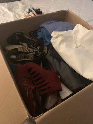 I have 3 boxes with 300 or more pieces clothes woman's medium size boys 10 years girl 12 years shoes 7 1/2 and 8 coat purses and more sale all 3 bo for Sale in Norcross, GA