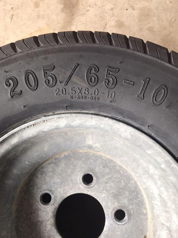 Trailer wheel spare tire
