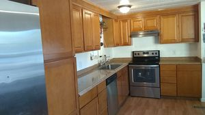 Use kitchen cabinets 12 total t ofop is oak buitton is maple for Sale in Winchester, CA