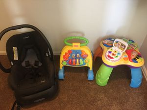 Car seat and toys for Sale in Fort Lupton, CO