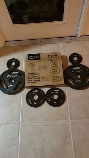Olympic Weights. Brand New Olympic 35lb set , 25lb set , 5lb set and 2.5lb set for Sale in Orlando, FL