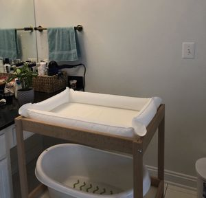 IKEA changing table with pad plus baby bath for Sale in Buffalo Grove, IL