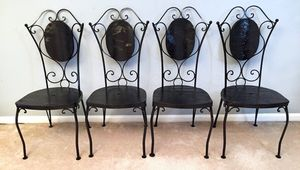 4 Black Heavy Wrought Iron and Wooden Chairs for Sale in Crofton, MD