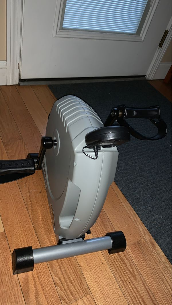 Pedal Exerciser. *BRAND NEW* never used. For range of motion. Can be used for arms and legs. Comes with hand/foot straps. Digital display shows speed