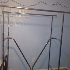 Clothing Rack Double Sided Rolls Has Wheels for Sale in Duncanville, TX