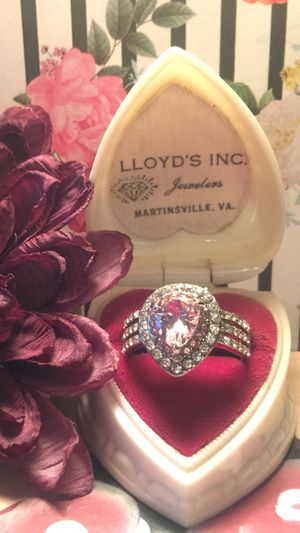 Beautiful teardrop pink Topaz with channel set white sapphires on three bands set on silver plated band sz 9 for Sale in Northfield, OH