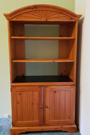 Solid wood cabinet with shelvesun for Sale in Eagle Creek, OR