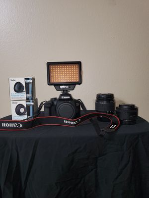 Canon EOS 4000D DSLR Camera (64GB Memory Card and Camera Light Included) for Sale in Houston, TX