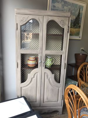 Antiqued display cabinet with shelves and light. Wire mesh doors. $525 for Sale in Paterson, NJ