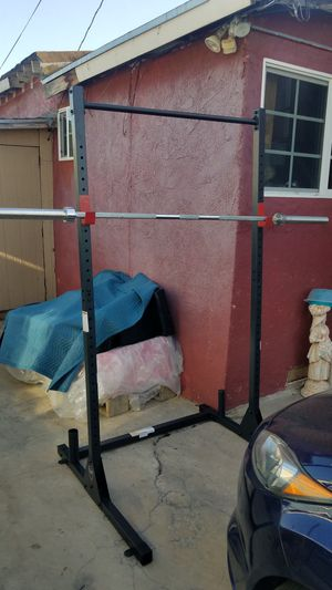 7 foot Olympic barbell 45lbs with clips and a Half Rack with pull up bar , plate and barbell holders. for Sale in Montebello, CA