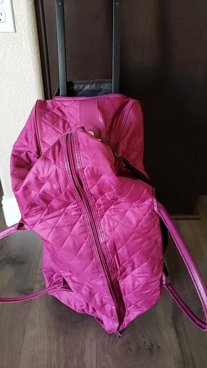 New Rolling Duffle Bag, padded Shoulder strap, carrying handles and zip hideaway rolling handle for Sale in Manteca, CA