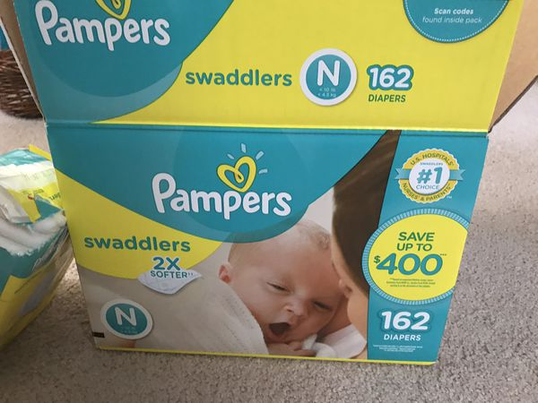 Newborns Pampers diapers ( about 195 counts)