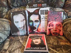 **BRAND NEW** $50 OBO! GREAT COLLECTION OF MARILYN MANSON ITEMS. 2 PAPERBACK BOOKS, 1 GUITAR MUSIC BOOK, A DVD AND CD COMBO PACK. for Sale in Cuyahoga Falls, OH