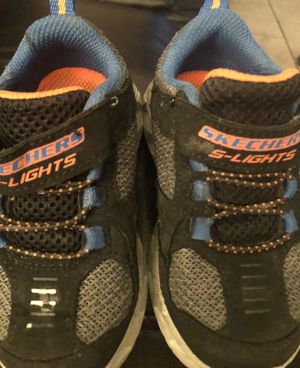 Sketchers lights - preowned in immaculate condition size 6 located off lake mead and jones area asking $5 for Sale in Las Vegas, NV