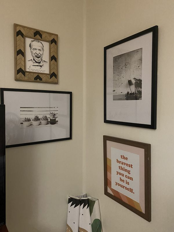 2 black and white framed pictures