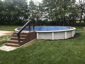 Great Escape 2013 Zodiac Pro 27' above ground pool. Includes everything: pump filter, vaccuum, wedding cake stairs, some chemicals and some inflatable for Sale in Hudson, IL