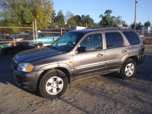2004 Mazda Tribute 200k miles runs and drives!!! for Sale in Temple Hills, MD
