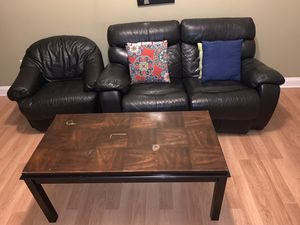 Used Black leather couch set/throw pillows and coffee table for Sale in Philadelphia, PA