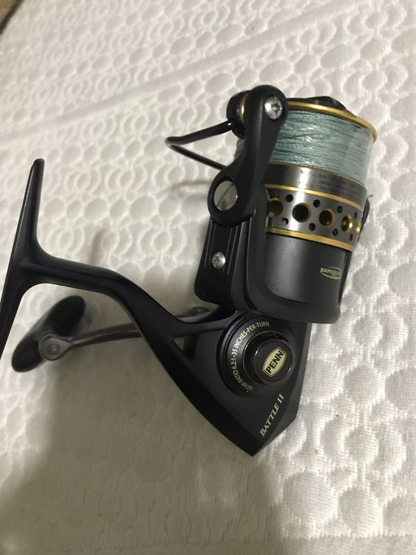 Penn battle II fishing reel used one time .. comes with braided line 3000 model