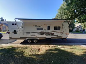 2012 Milan bunkhouse it's 26ft half-ton towable with a super slide-out power awning and jacks has bunk beds and u-shaped dining table for Sale in Fresno, CA