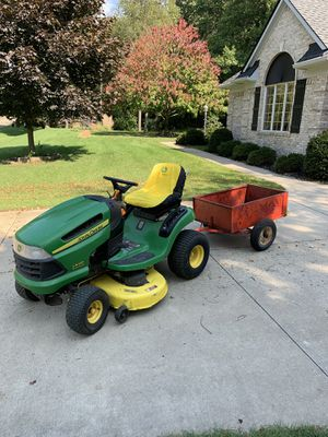 "John Deere riding lawn tractor with trailer 42"" cut excellent condition for Sale in White Lake charter Township, MI"