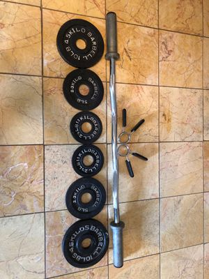 Olympic size weights and curl bar for Sale in Los Angeles, CA