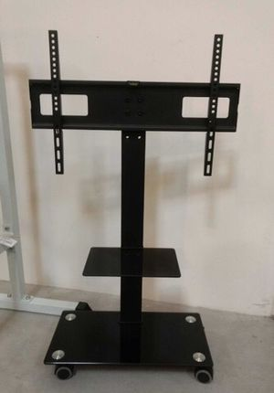 Brand new in box TV stand on wheels universal fits 32 to 65 Inch TV sizes flat screen LCD plasma with glass shelf for Sale in El Monte, CA