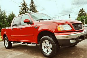 Red truck ' Ford F-150 2002 Lariat Kept garage ! for Sale in Buffalo, NY