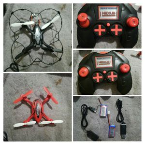2 Camera Drones as pictured two controllers, 2 chargers 4 batteries $35.00 each open to cash offers or trades for one or both for Sale in Prospect, VA