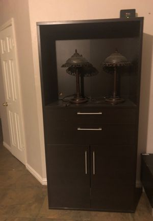 Small armoire and lamps. Brown armoire and oil bronze finish on lamps for Sale in Mesquite, TX