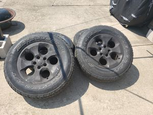 Used Jeep Wrangler factory rims and tires. 18 inch tires, Rims have paint that can be peeled off and back to factory aluminum for Sale in Dolton, IL