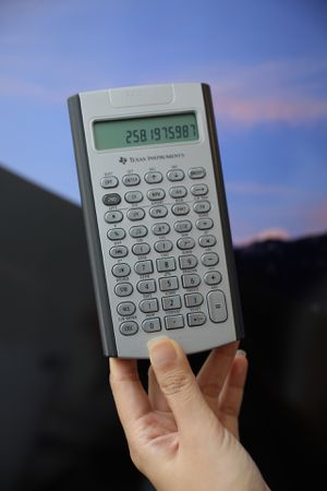 Texas Instruments BAII Plus Business Calculator - with leather cover Working perfectly! for Sale in The Bronx, NY