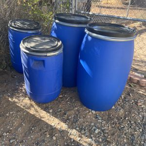 Barrels /15 Gallons Plastic Open Top w/sealed lids & rings for Sale in Victorville, CA
