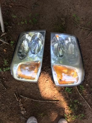 Newer model Suburban headlights brand new for Sale in Nathalie, VA