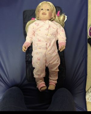 Toddler Doll with suit case full of clothes and a changing mat for Sale in Manalapan Township, NJ