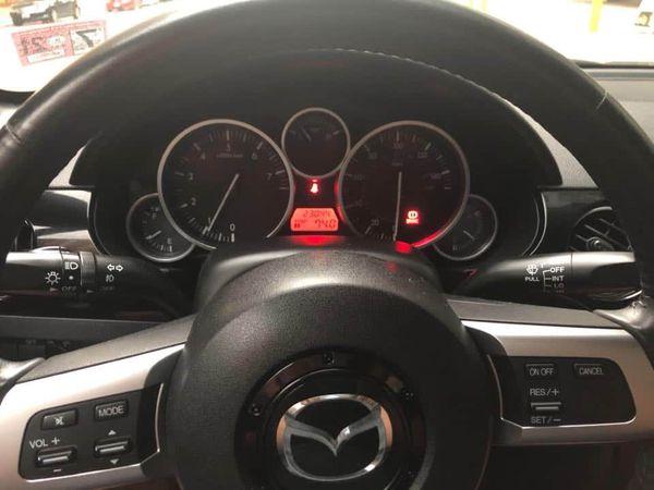 2008 Mazda Miata with 23000 miles.