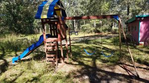 Outdoor wooden playhouse and swingset for Sale in Spring Hill, FL