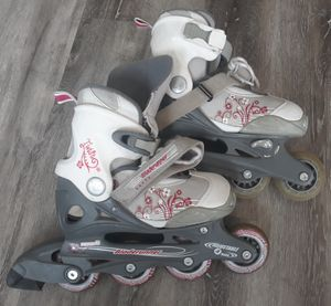 Girls Rollerblades - Adjustable - Abec 3 - Gently Used for Sale in Longmont, CO