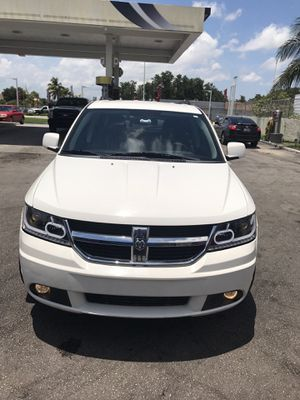 Dodge Journey 2010 clean title its condition ac works really good 1,29197 miles on the vehicle car only does maintenance at the dealership for Sale in Miami, FL