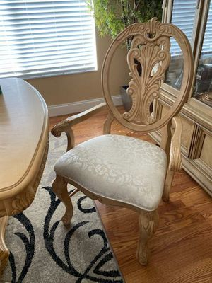 Wooden table and 8 fabric chairs for Sale in Tampa, FL