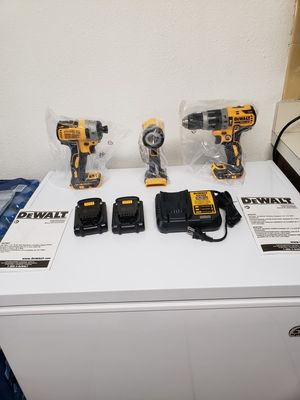 Dewal three tool kit.20 volt drill driver Impact driver two batteries, charger and bonus flashlight. New never used. for Sale in Tampa, FL