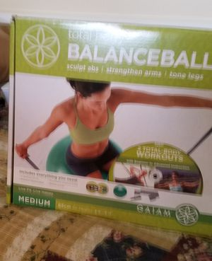 Balance ball with 2 dvds for Sale in Tampa, FL