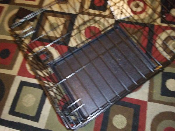 Med. Size fold up Dog Cage like new asking 20$ firm 2 foot long 1/ 1/2 in height