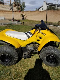 2002 honda sport trax starts and runs . Starts first pull and idles simi automatic 3 gears both breaks work for Sale in Fontana,  CA