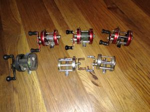 4 vintage Ammbassaduer 5000 reels 1 pflueger and 1 game getter reels all work really good shape for Sale in Tupelo, MS
