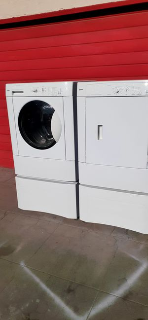 Kenmore front load washer and dryer with pedestals for Sale in Fresno, CA