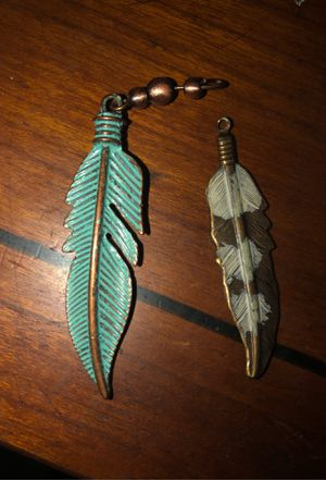 Turquoise Blue Feather Charm and bronze and white Feather Charm for Sale in Plainfield, IL