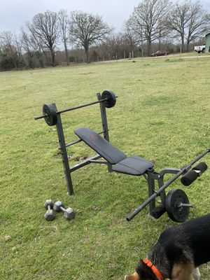 Total work out weight bench with 2bars,16 weights, and 2dumb bells for Sale in Fruitvale, TX