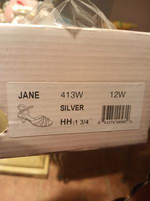 Women's silver shoes size 12w for Sale in Melbourne Village, FL
